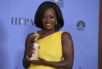"Viola Davis poses in the press room with the award for best performance by an actress in a supporting role in any motion picture for ""Fences"" at the 74th annual Golden Globe Awards at the Beverly Hilton Hotel on Sunday, Jan. 8, 2017, in Beverly Hills, Calif."