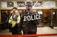 Police stand guard at the rope line outside of an presidential inauguration party at the Warner Theatre due to street protests, Thursday, Jan. 19, 2017, in Washington.