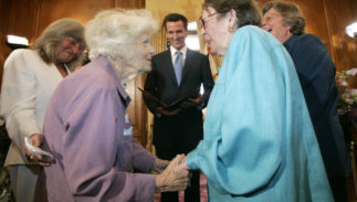 Del Martin, center left, and Phyllis Lyon, center right, are married by San Francisco Mayor Gavin Newsom ,center, in a special ceremony at City Hall in San Francisco, Monday, June 16, 2008. Also pictured are the couple's witnesses, Roberta Achtenberg, left, and Donna Hitchens. Lyon and Martin became the first officially married same sex couple after California's Supreme Court declared gay marriage legal.