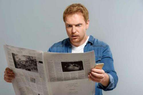 man surprised newspaper