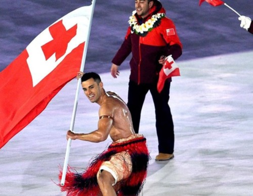oiled shirtless tonga flag bearer