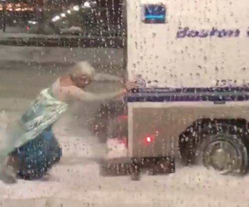 Man Dressed As Elsa Rescues Boston Police Wagon From Very Frozen Mishap