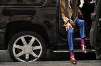 Stock photo of a Lyft rider exiting car