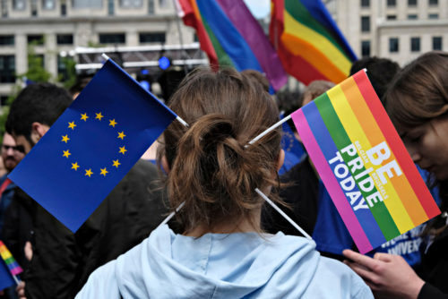 Participant has Rainbow and European flag in his hair during the Belgian Gay Pride parade in Brussels Belgium on May 20, 2017