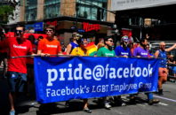 Pride Facebook group with their blue banner at the 2014 LGBT Pride Parade on Fifth Avenue in NYC.