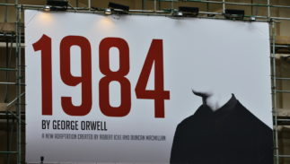 A billboard advertising Robert Icek and Ducan MacMillans theatrical adaptation of George Orwells Nineteen Eighty-Four on May 30, 2015 in London, UK.