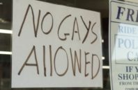 "Sign on a store window reading ""NO GAYS ALLOWED"""
