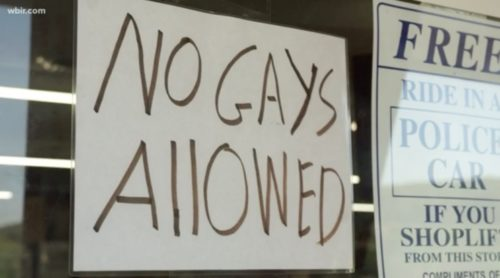 """Sign on a store window reading """"NO GAYS ALLOWED"""""""