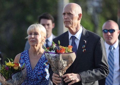 Rick Scott pays tribute the 49 Pulse shooting victims wearing a rainbow ribbon.