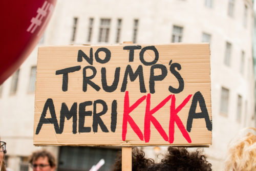 "Protest sign reading ""No to Trump's Amerikkka"""