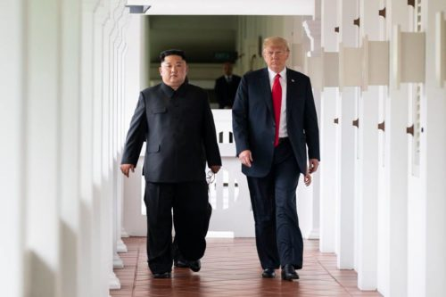 President Trump and North Korean dictator Kim Jong Un walk together during their summit in Singapore.