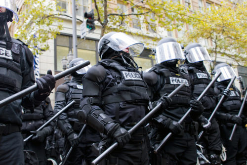 Police in riot gear hold the line in Downtown Portland, Oregon during an Occupy Portland protest on the first anniversary of Occupy Wall Street November 17, 2011