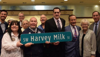 Portland City Council members pose with a sign for SW Harvey Milk St.