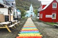 Rainbow brick path through the center of town in Seyðisfjörðuris, Iceland