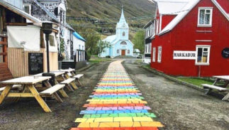 Rainbow brick path through the center of town in Seyðisfjörðuris, Iceland
