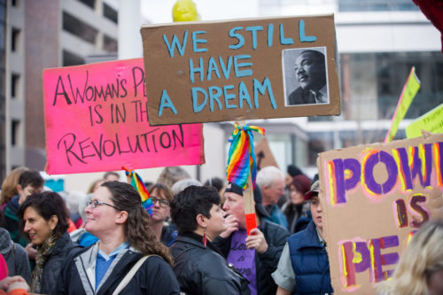 "December 3, 2016: A participant in the Portland Women March Against Hate carry signs reading ""We still have a dream"""