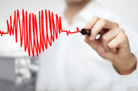 A clinician draws an image of a heart in the style of an ekg