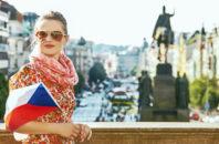 A woman holds a Czech flag in Prague