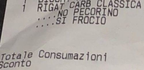 Close up of a slur left on a gay couple's restaurant receipt