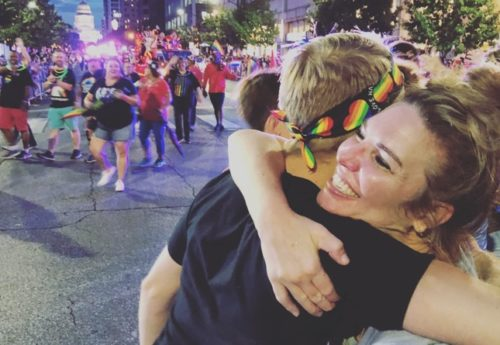 "Jen Hatmaker gives a ""mom hug"" at Austin Pride"