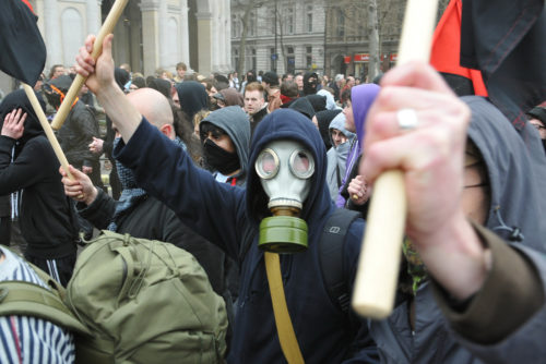 A breakaway group of anarchist protesters march through the streets of the British capital during a large anti-cuts rally on March 26, 2011 in London, UK.