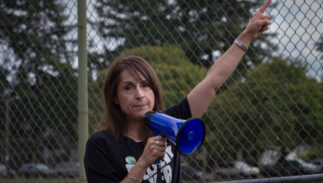 Portland, OR – September 30, 2018: Hundreds gathered at Rose City Park in protest against the nomination of Brett Kavanaugh for the U.S. Supreme Court, and in support of Dr. Christine Blasey Ford.
