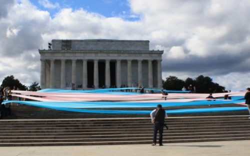 Activists unfurled a 150-foot trans flag on the steps of the Lincoln Memorial to protest the Trump administration's attacks on transgender people.