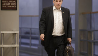 """FILE - In this Friday, Feb. 3, 2017, file photo, Sen. Joe Donnelly, D-Ind., arrives early on Capitol Hill in Washington. Donnelly says he'll support the nomination of Judge Neil Gorsuch to the U.S. Supreme Court. The Indiana Democrat announced his support on Sunday, April 2, 2017, for President Donald Trump's pick, calling Gorsuch """"a qualified jurist who will base his decisions on his understanding of the law and is well-respected among his peers."""" Donnelly faces a tough re-election in 2018."""