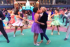The Prom stars Caitlin Kinnunen and Isabelle McCalla share a smooch during the Macy's Thanksgiving Day Parade.