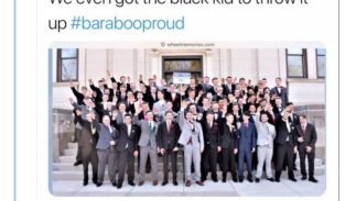 A screenshot of a tweet with a picture of a group of white teenagers holding up one arm
