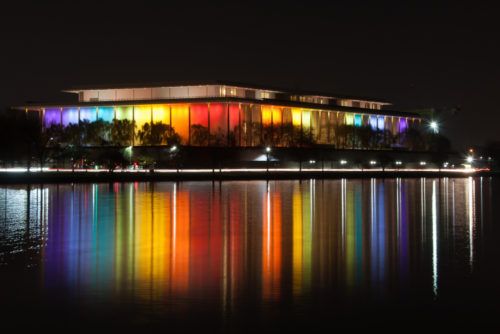 The Kennedy Center for the Performing Arts is lit up in rainbow colors for the Kennedy Center Honors in Washington DC on December 4, 2017
