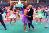 Two actresses kiss during the Macy's parade.