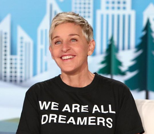 """Ellen wearing a black T-shirt that says """"We are all dreamers."""""""