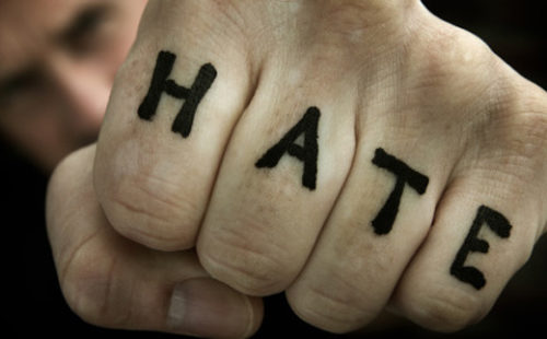 """HATE"" tattooed on someone's hand."