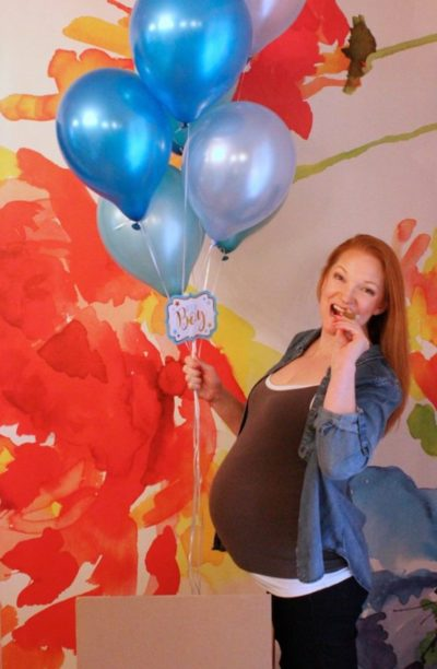 Heather Green holding blue balloons