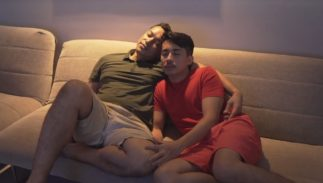 A Malaysian gay couple watching TV