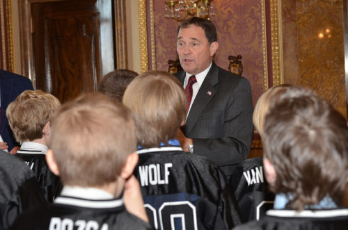 Utah Governor Gary Herbert speaks to the Pee Wee Alto White Champion football team in March 2013.