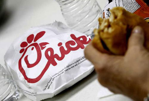 A Chick-fil-a sandwich with the logo