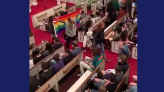 Students waved a rainbow flag as they walked out en masse to protest Jeff Sessions' speech