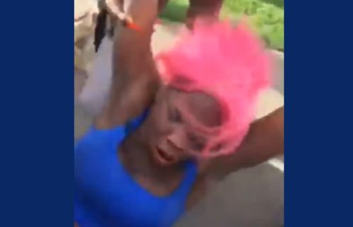 A transgender woman being dragged away