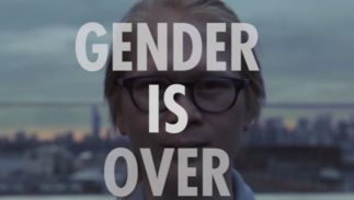 "A person wearing glasses with the words ""Gender is over"""