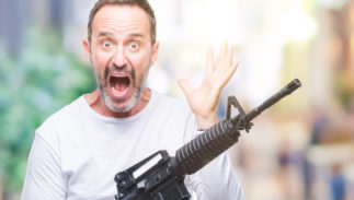 NRA, Wayne LaPierre, Oliver North, scandal, National Rifle Association