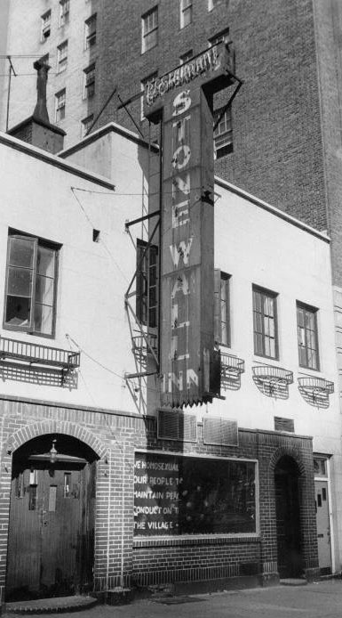 A photo of the Stonewall Inn, showing the Mattachine Society's sign in the aftermath of the riots.