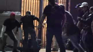 A group of men beating someone