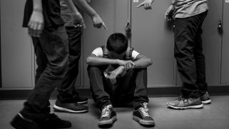 Gay teen beaten in locker room by gang of boys while another student recorded it