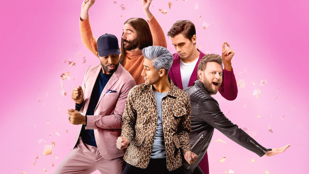 The 5-member cast of Netflix's Queer Eye, also known as the Fab Five, poses in front of a pink studio backdrop.