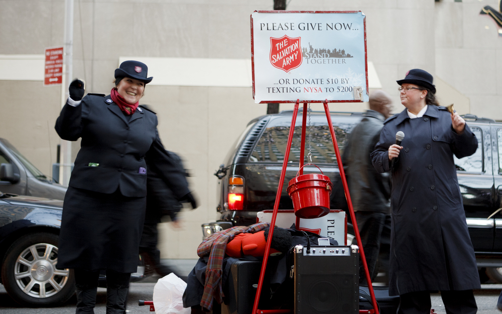 Cheerful Salvation Army people collecting for the Holidays at Rockefeller Center.