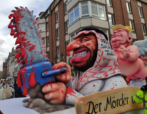 Düsseldorf, Germany, March 3 2019, carnival parade, float showing prince salman and naked Donald Trump