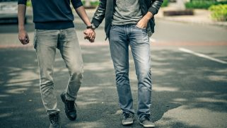 Gay couple beaten by a gang of men for holding hands at a food truck