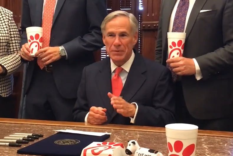 "Texas Governor Greg Abbott surrounded himself with fast food sandwiches to sign the ""Save Chick-fil-A"" bill into law."